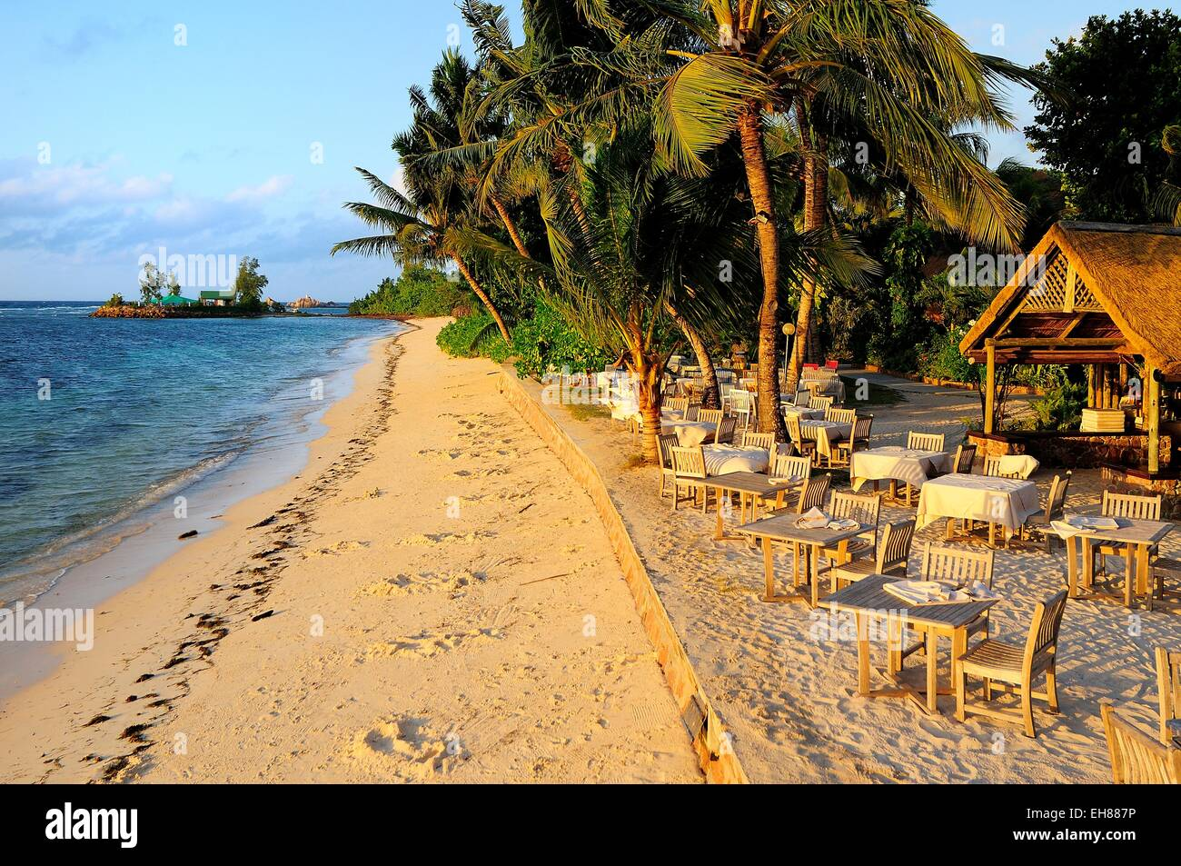 Bar on the beach at sunset, La Digue Island, La Digue and Inner Islands, Seychelles - Stock Image