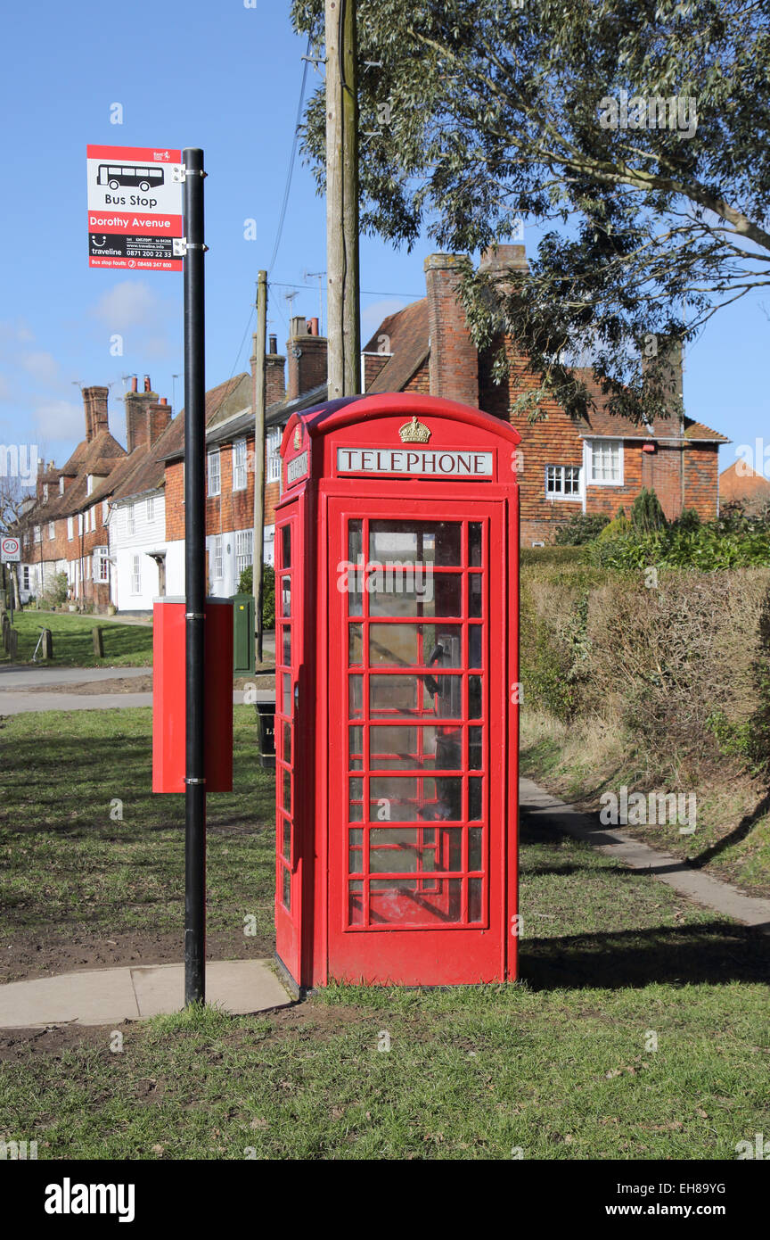 bus stop and red telephone box in woodchurch kent - Stock Image