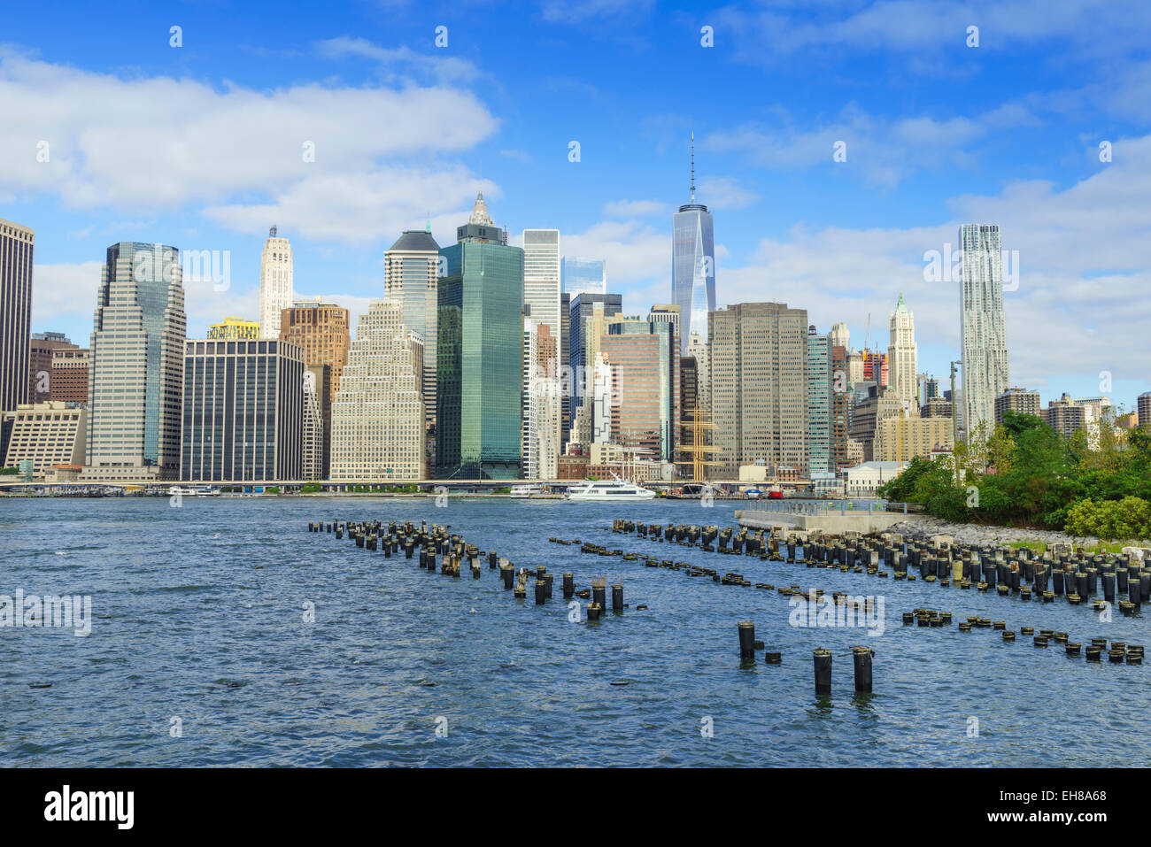 Lower Manhattan skyscrapers including One World Trade Center from across the East River, Manhattan, New York City, Stock Photo