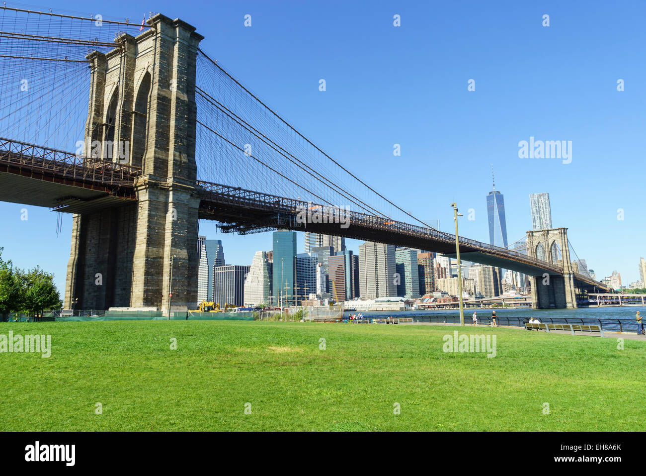 Brooklyn Bridge and Lower Manhattan skyscrapers including One World Trade Center, New York City, New York, USA - Stock Image
