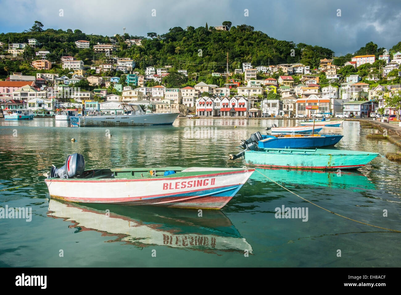 Little motoboat in the inner harbour of St. Georges, capital of Grenada, Windward Islands, West Indies, Caribbean - Stock Image
