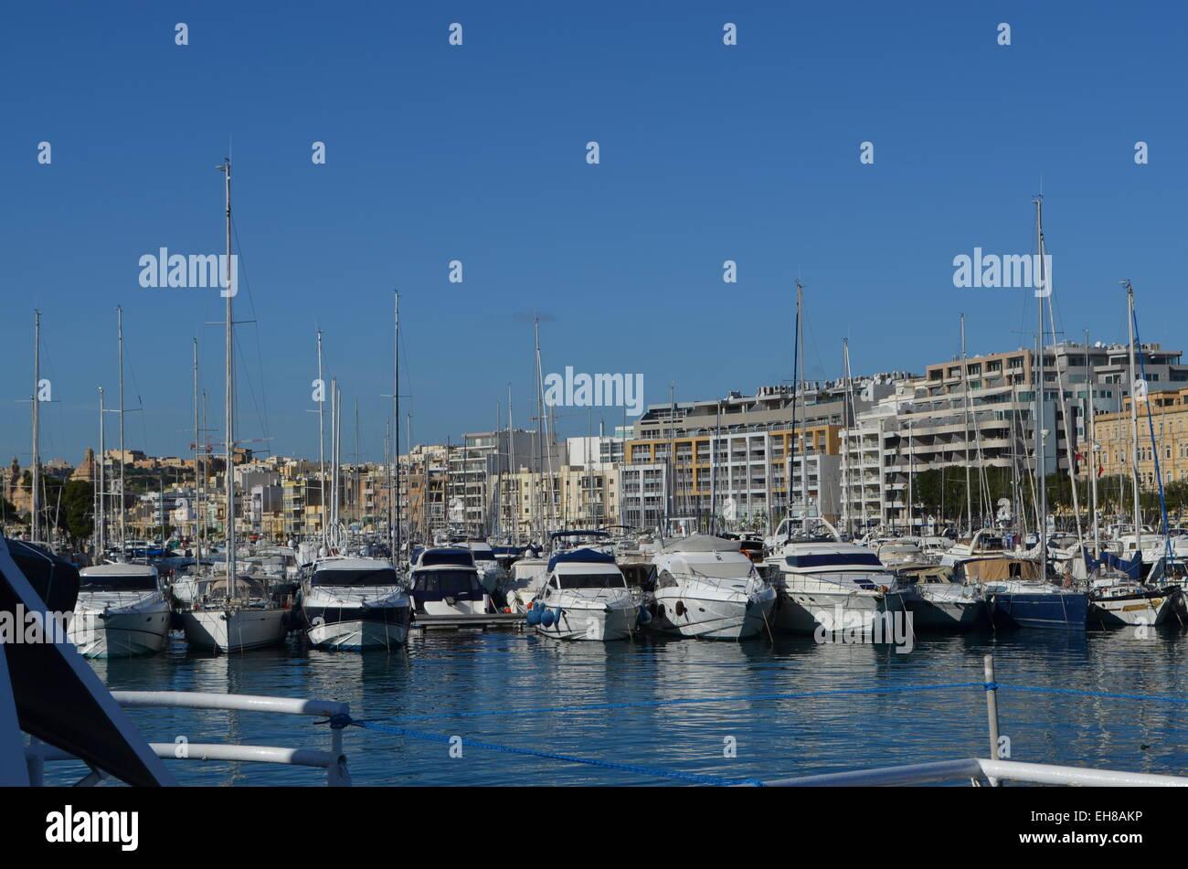 Valletta, A great variety of small sailing boats and yachts  at anchor along the Sliema waterfront. - Stock Image