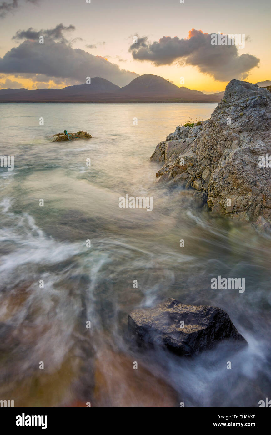 Isle of Jura and Paps of Jura Mountains across Bunnahabhain Bay and Sound of Islay from Islay, Argyll and Bute, - Stock Image