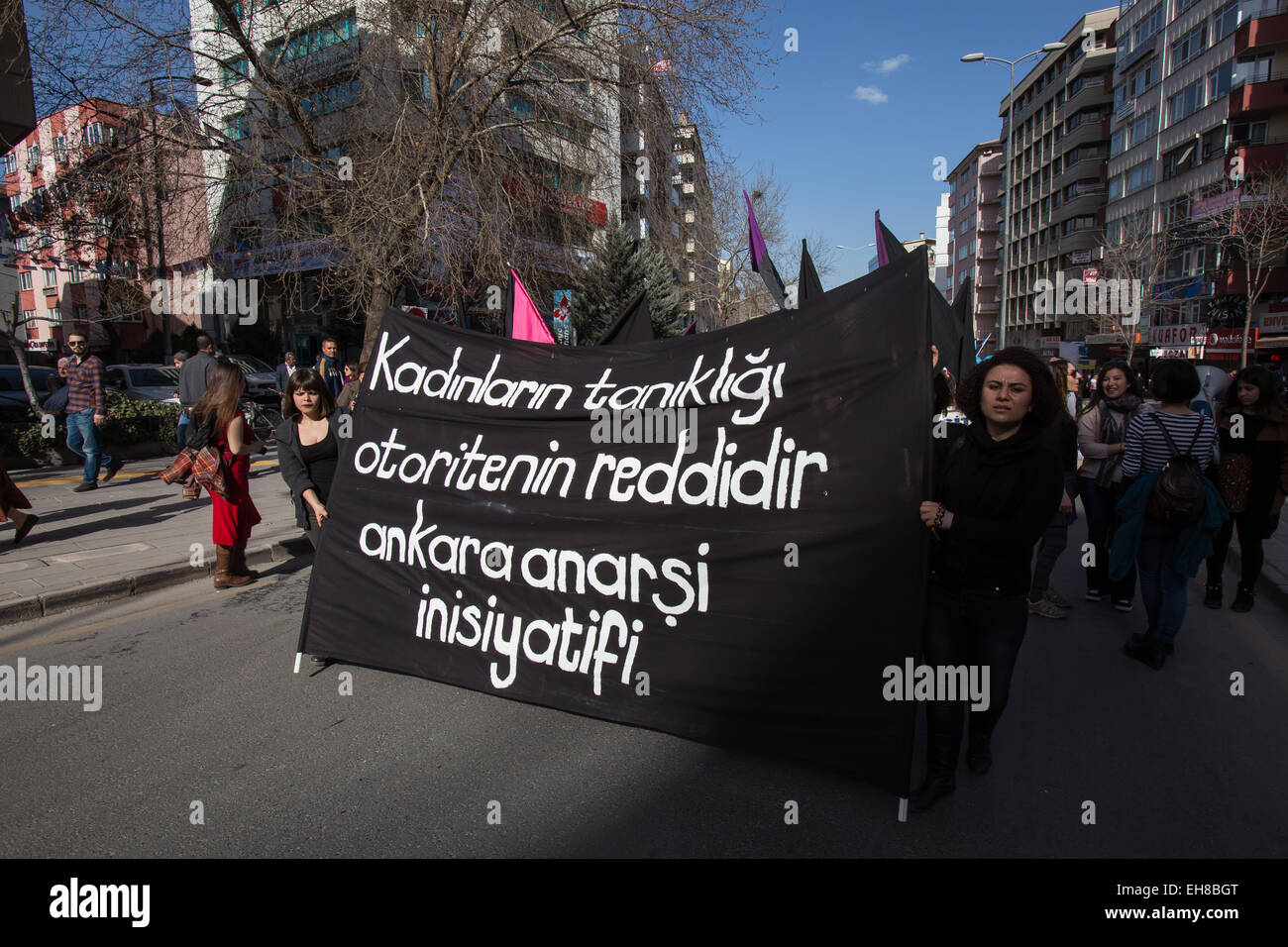 "Women of the ""Ankara Anarchist Initiative"" hold a banner reading ""Women rejects authoritarianism"" during a demonstration Stock Photo"