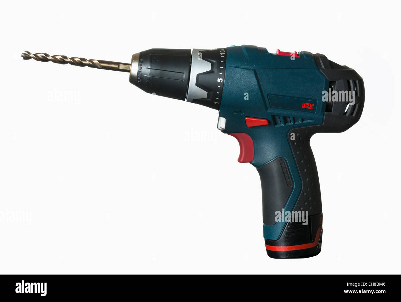 Cordless drill with large bit on white background - Stock Image