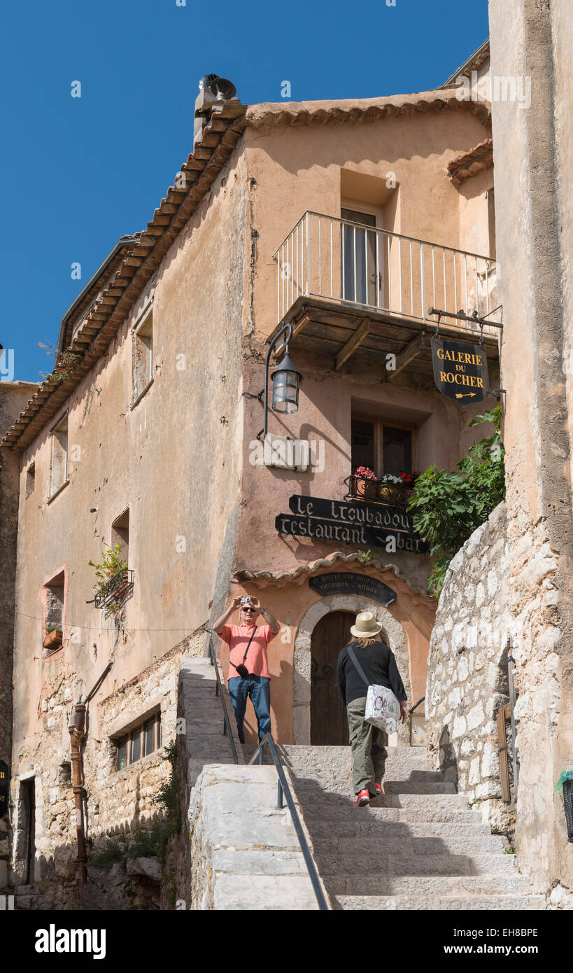 French village of Eze, Provence, Alpes-Maritimes, France, Europe with tourists taking photographs - Stock Image