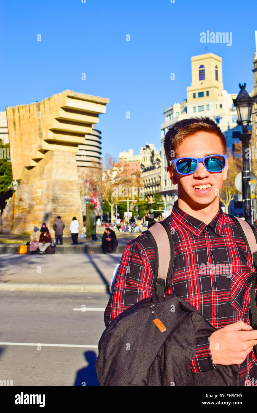 A smiling boy with sunglass at Catalunya square. Barcelona, Catalonia, Spain. - Stock Image