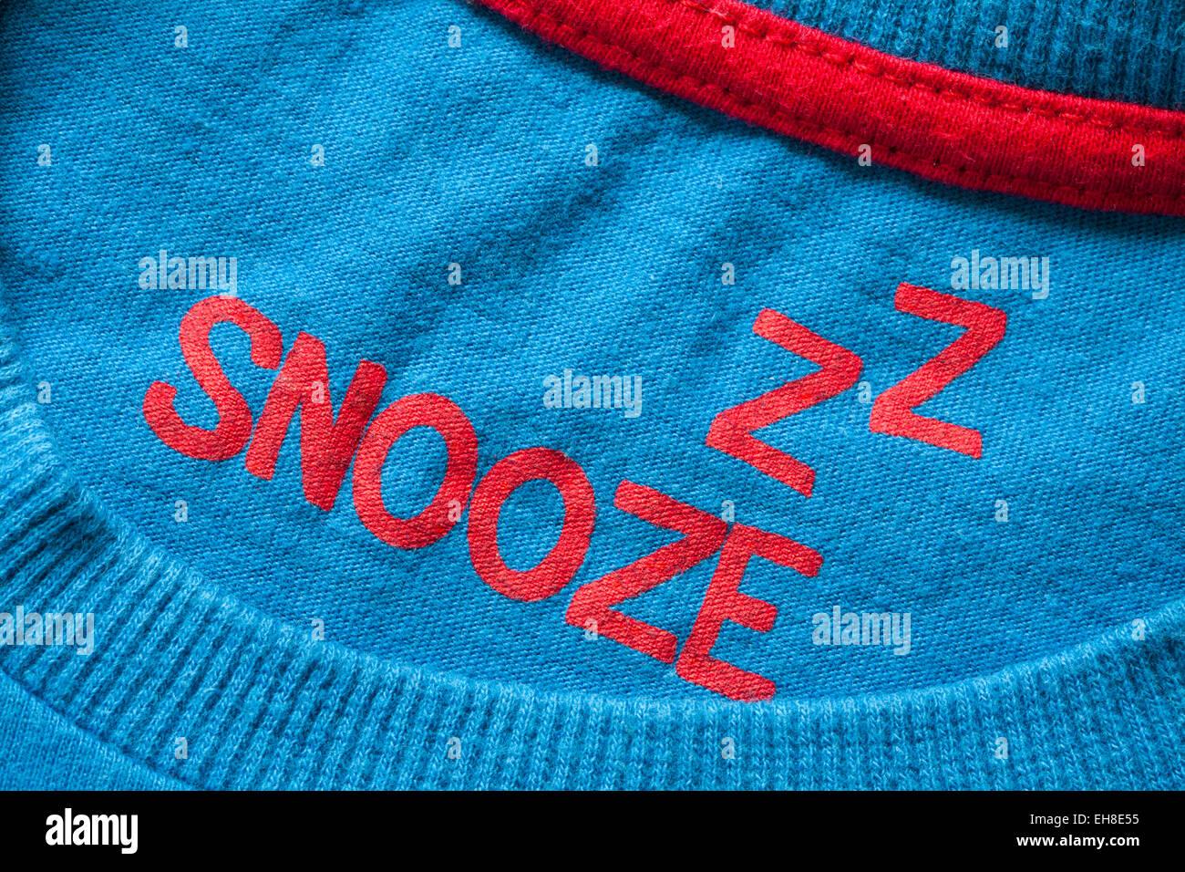 Z Z snooze stamped in child's top garment, part of pyjamas set - Stock Image