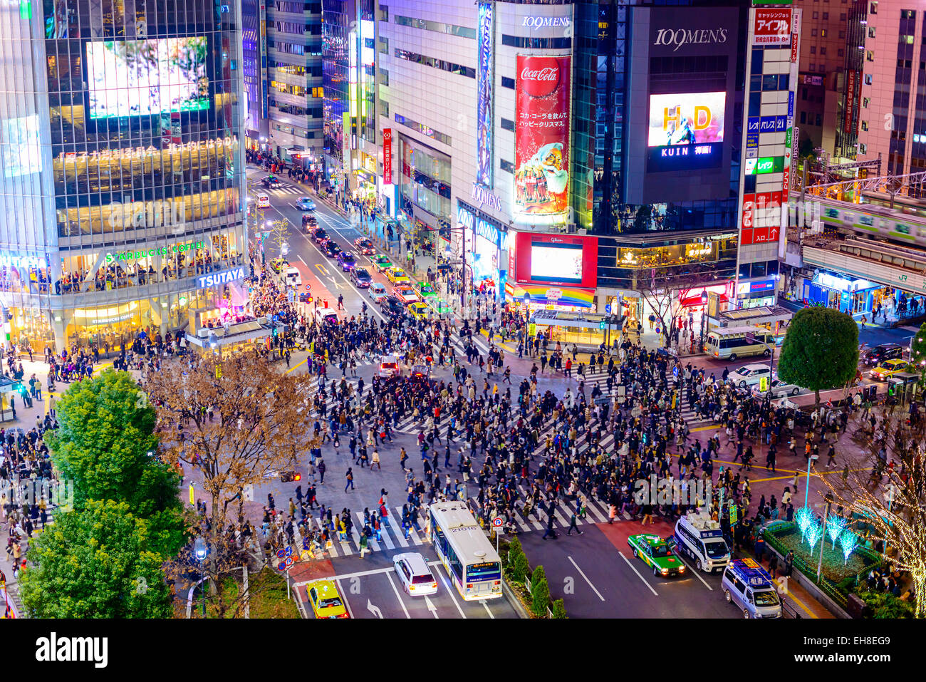 Pedestrians cross at Shibuya Crossing. It is one of the world's most famous scramble crosswalks. - Stock Image
