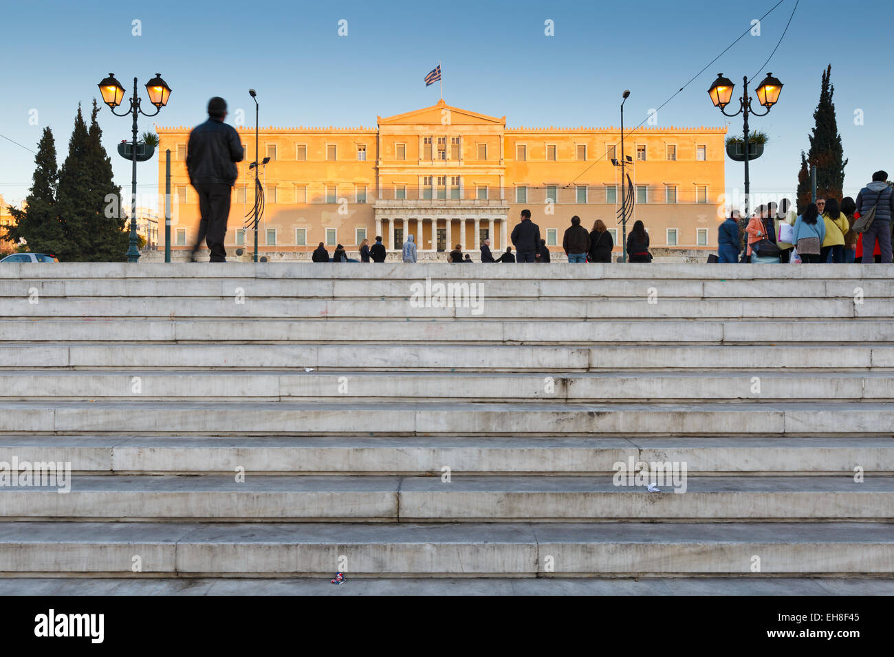 Tourists at Syntagma square in front of the parliament, Athens - Stock Image
