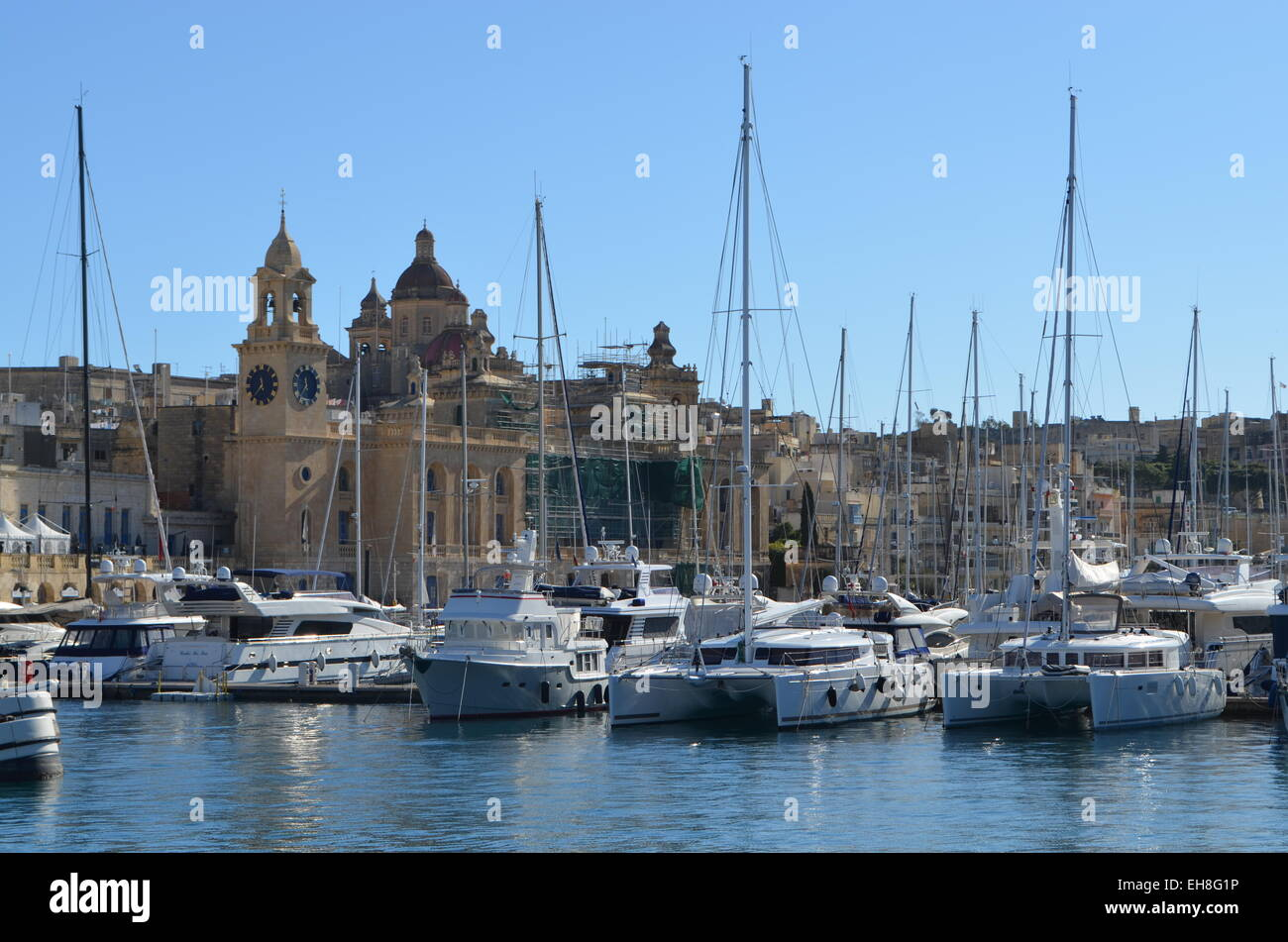 Valletta A great variety of small sailingboats and yachts at anchor along the waterfront. They areused by the peoplefor - Stock Image