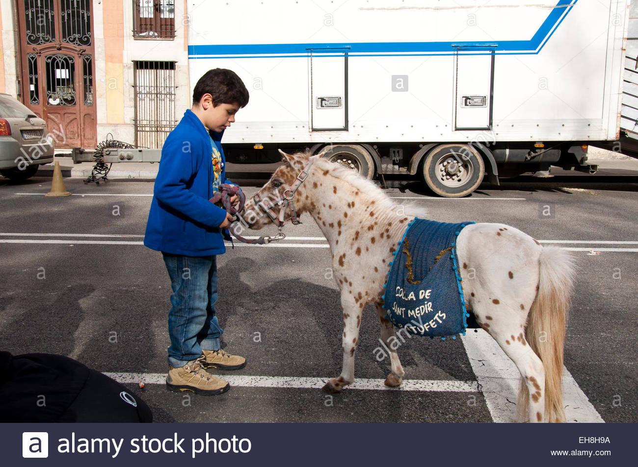 Little boy whit a pony, Fiesta de Sant Medir 2015 Gracia Barcelona Spain - Stock Image