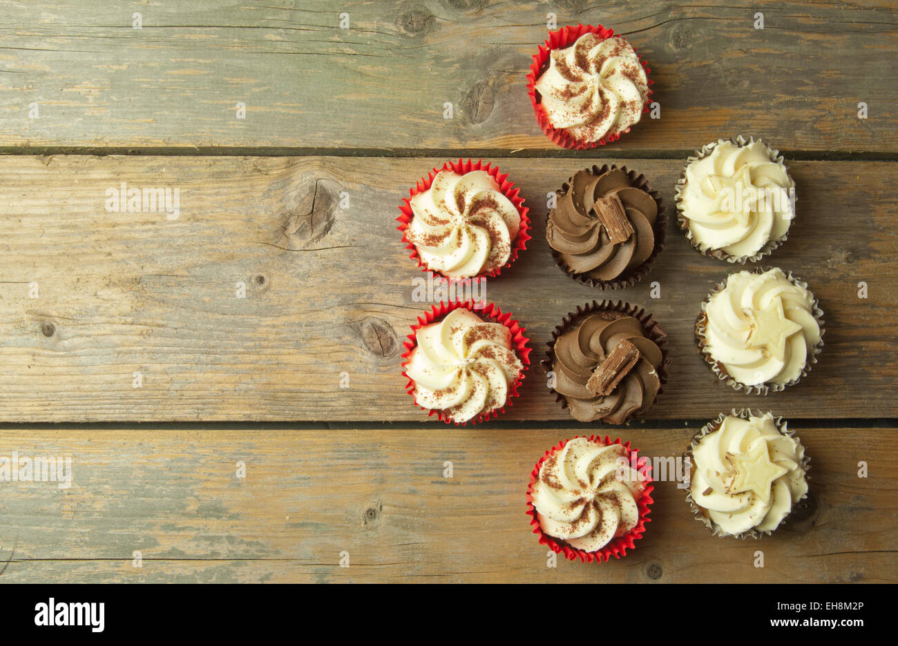 Assorted cupcakes with space for text - Stock Image