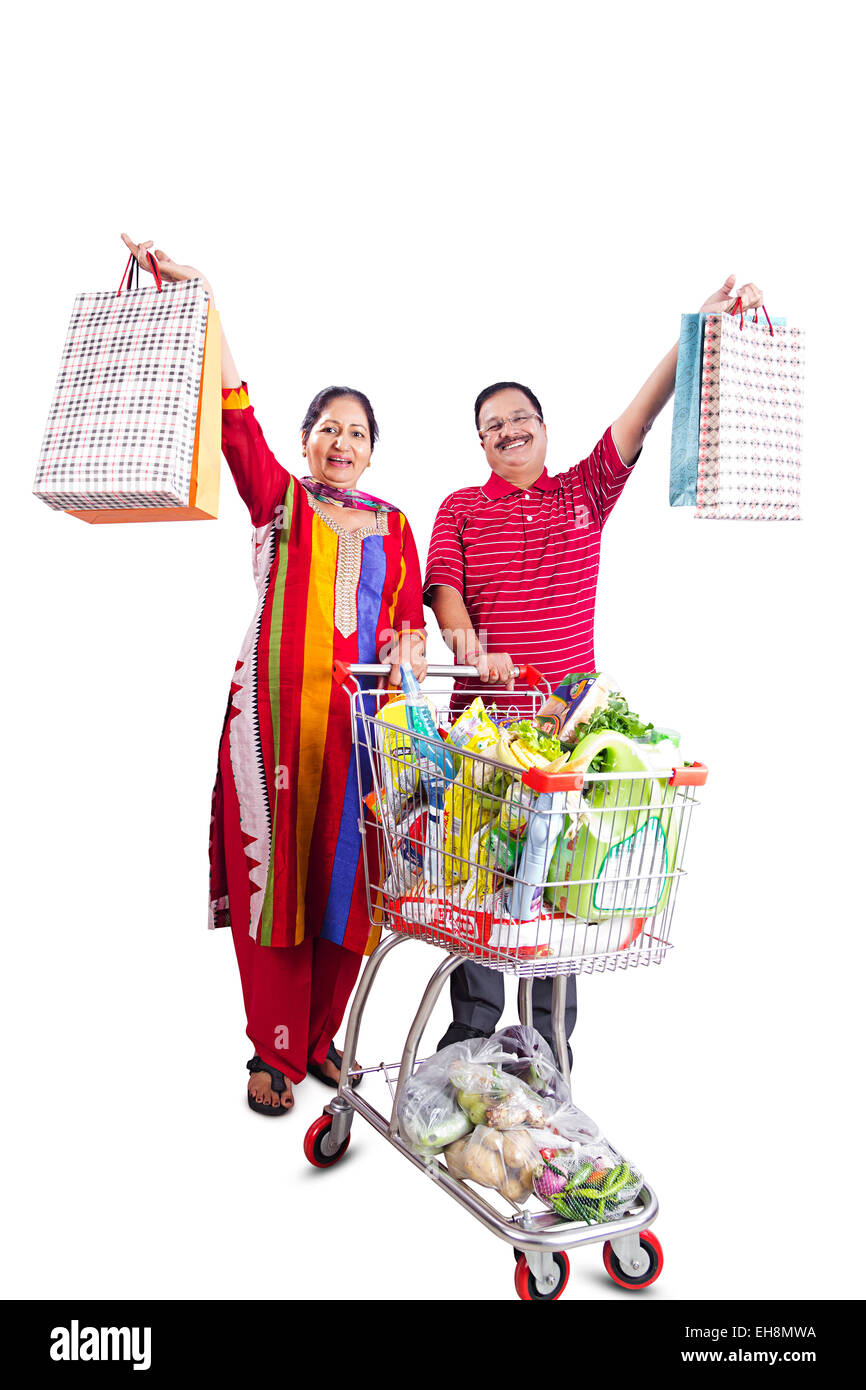 2 indian Seniors  Married couples trolley Shopping - Stock Image