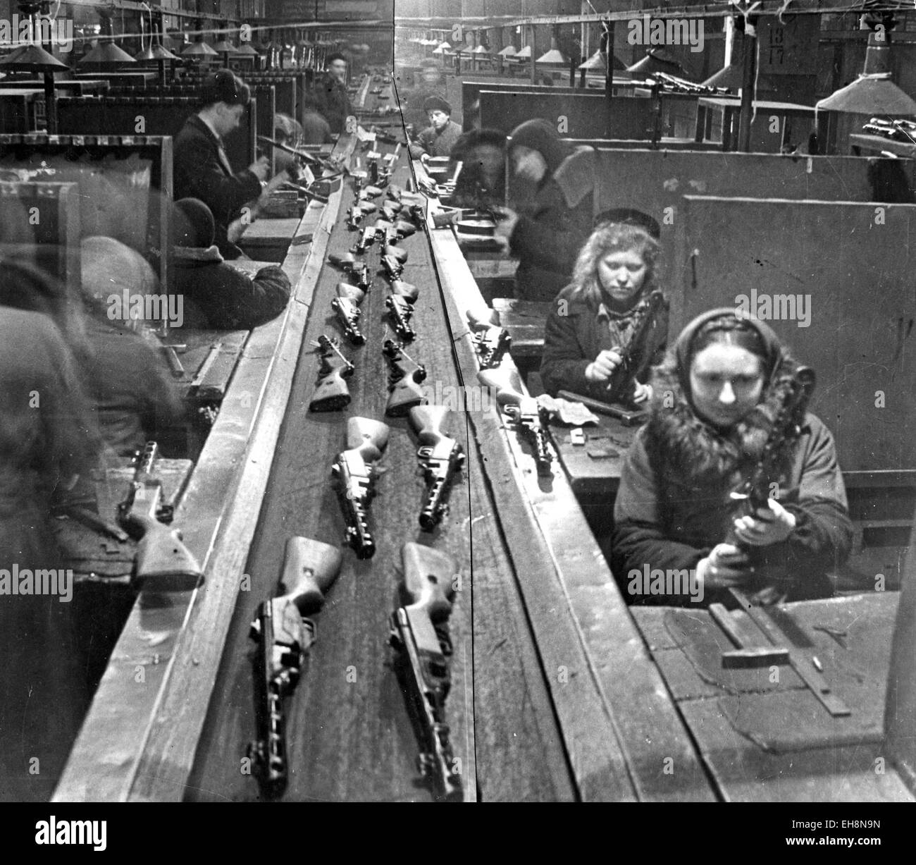 SOVIET ARMAMENTS Women workers fitting out  PPSH-41 submachine guns on a factory production line about 1943 - Stock Image