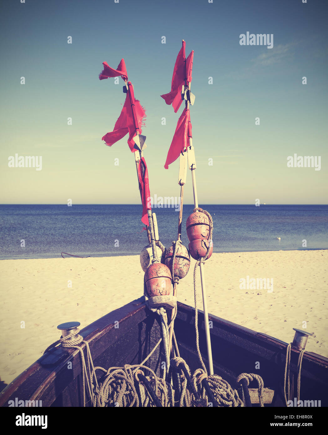 Retro filtered photo of fishing boat on beach, Baltic Sea, Germany. - Stock Image
