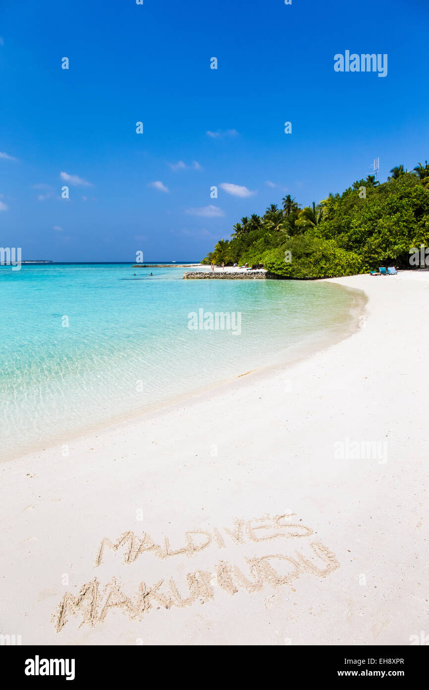 A view of the beach at Makunudu Island in the Maldives with writing in the sand - Stock Image