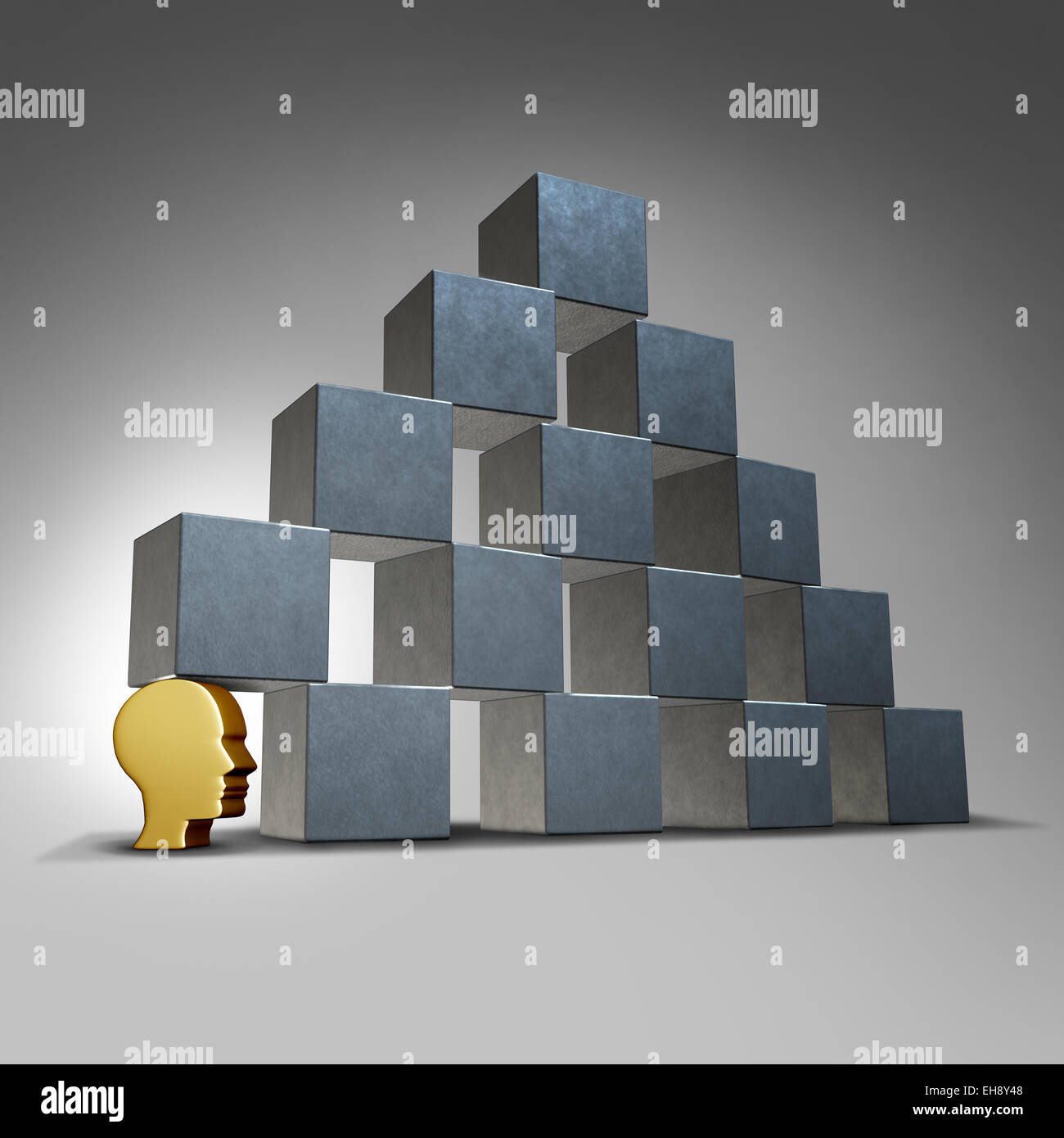 Essential services and crucial support concept as a head icon supporting a group of blocks in a pyramid formation - Stock Image