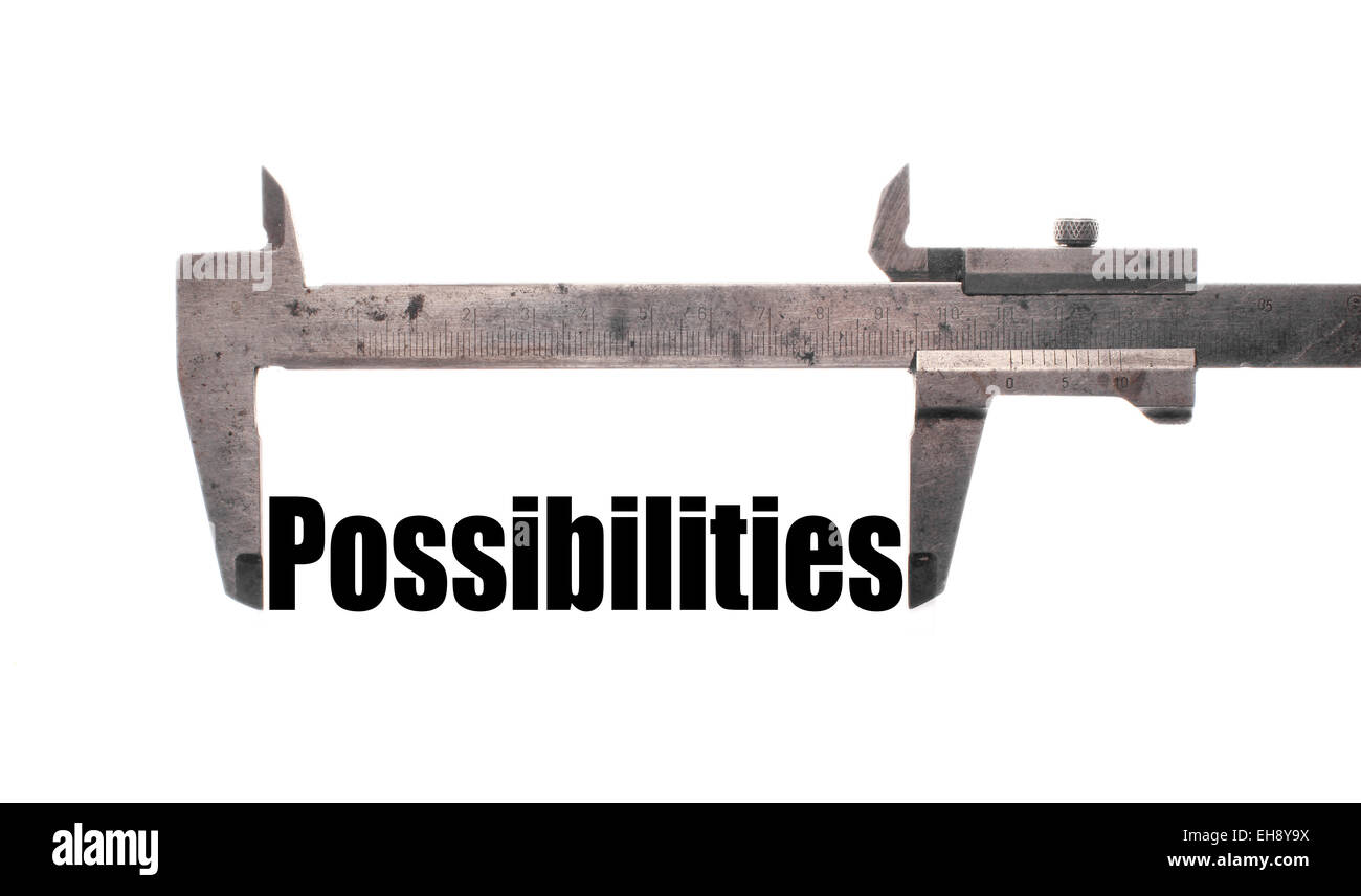 Color horizontal shot of a caliper and measuring the word 'possibilities'. - Stock Image