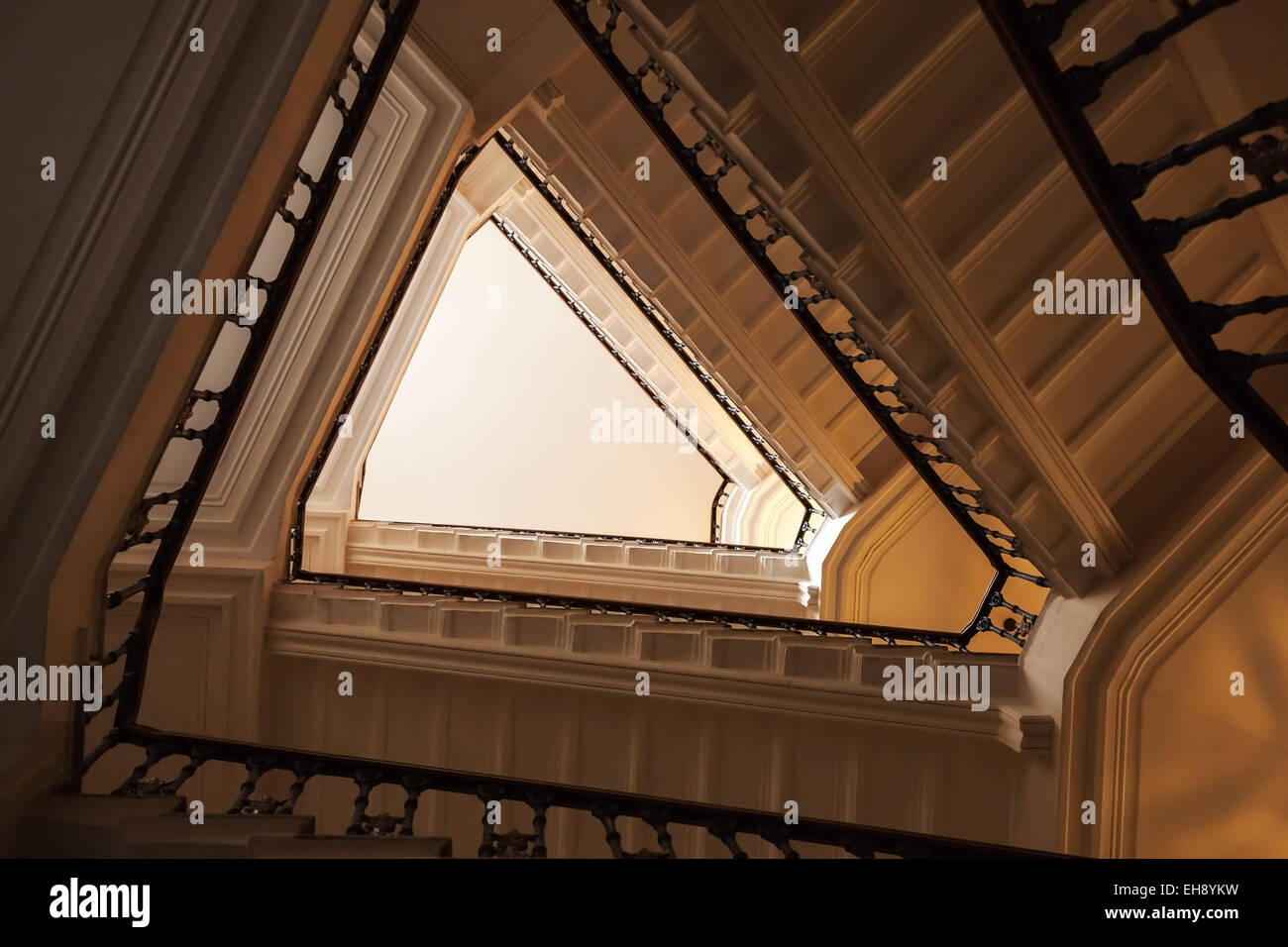 Abstract interior fragment, triangle shaped flight of stairs, looking up - Stock Image