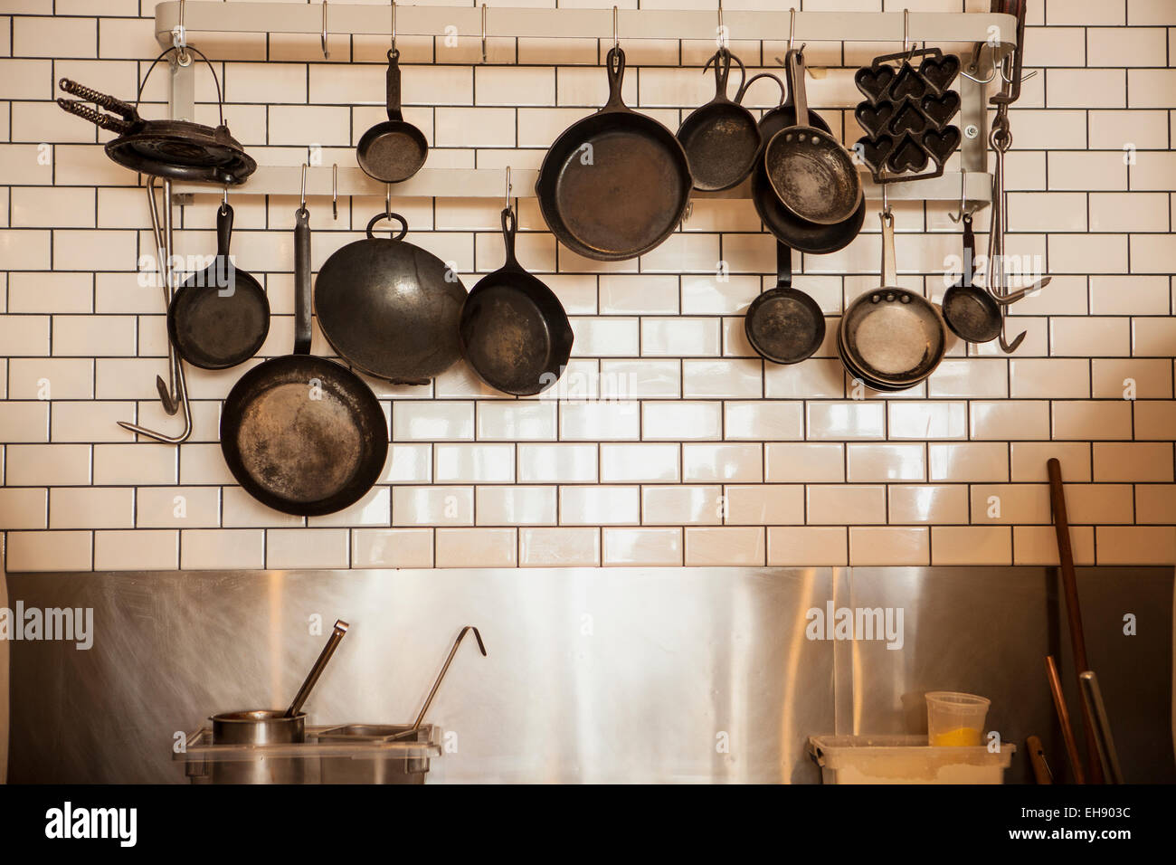 Cast Iron Frying Pans Hanging In Kitchen, Industrial Eats Restaurant,  Buellton, California