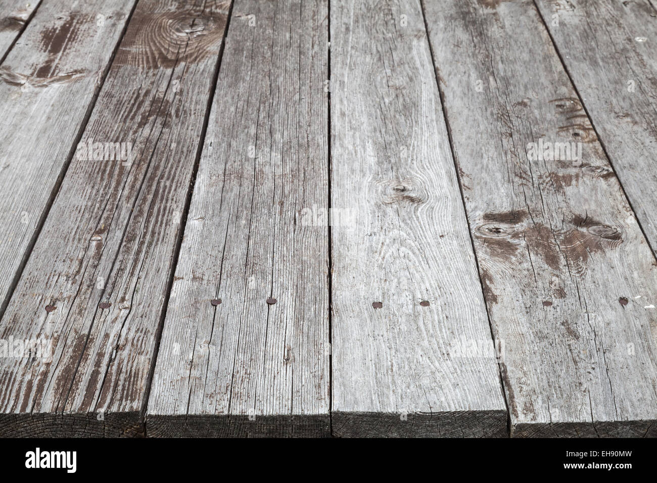 Old gray wooden table, background photo texture with perspective effect - Stock Image