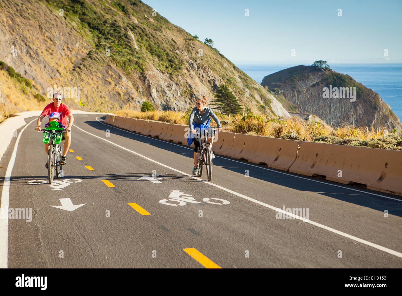 family bicycling Devil's Slide Coastal Trail, near Half Moon Bay, California - Stock Image