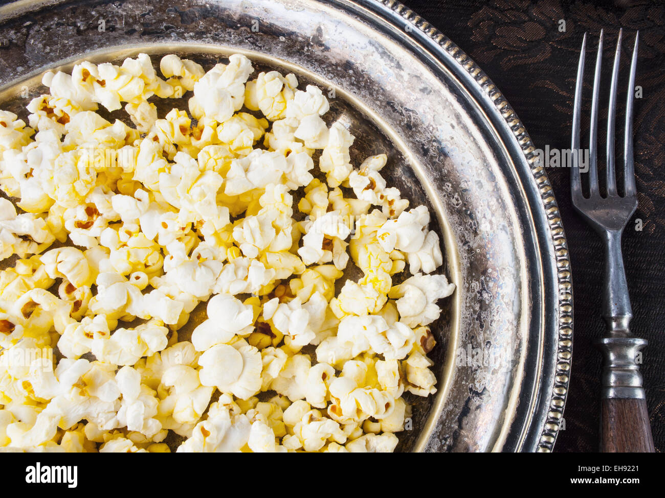 Healthy Buttered Popcorn with Salt in a Plate Stock Photo