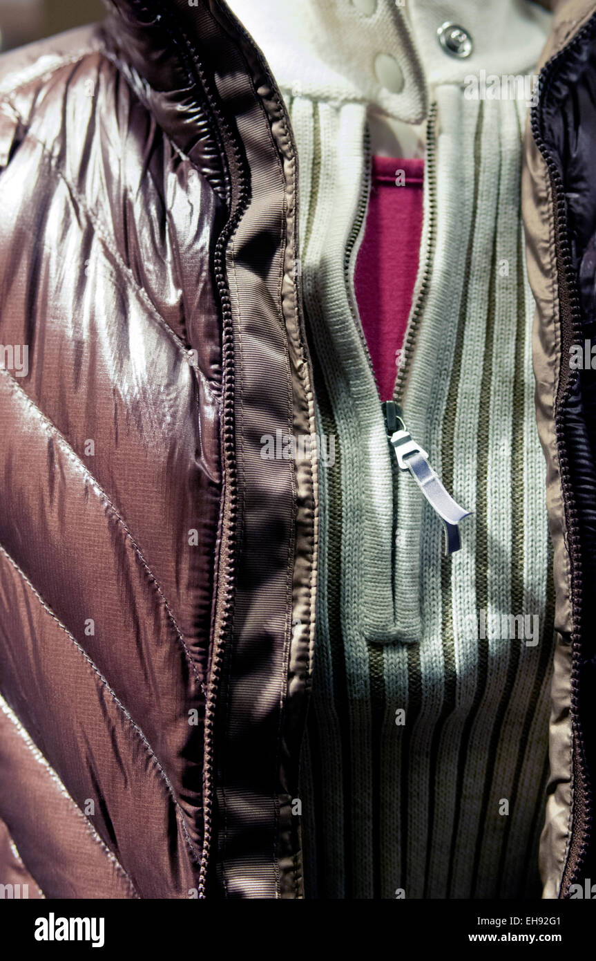 Mannequin wearing a ribbed brown jacket, mint knit zippered shirt and a burgundy pullover shirt. - Stock Image