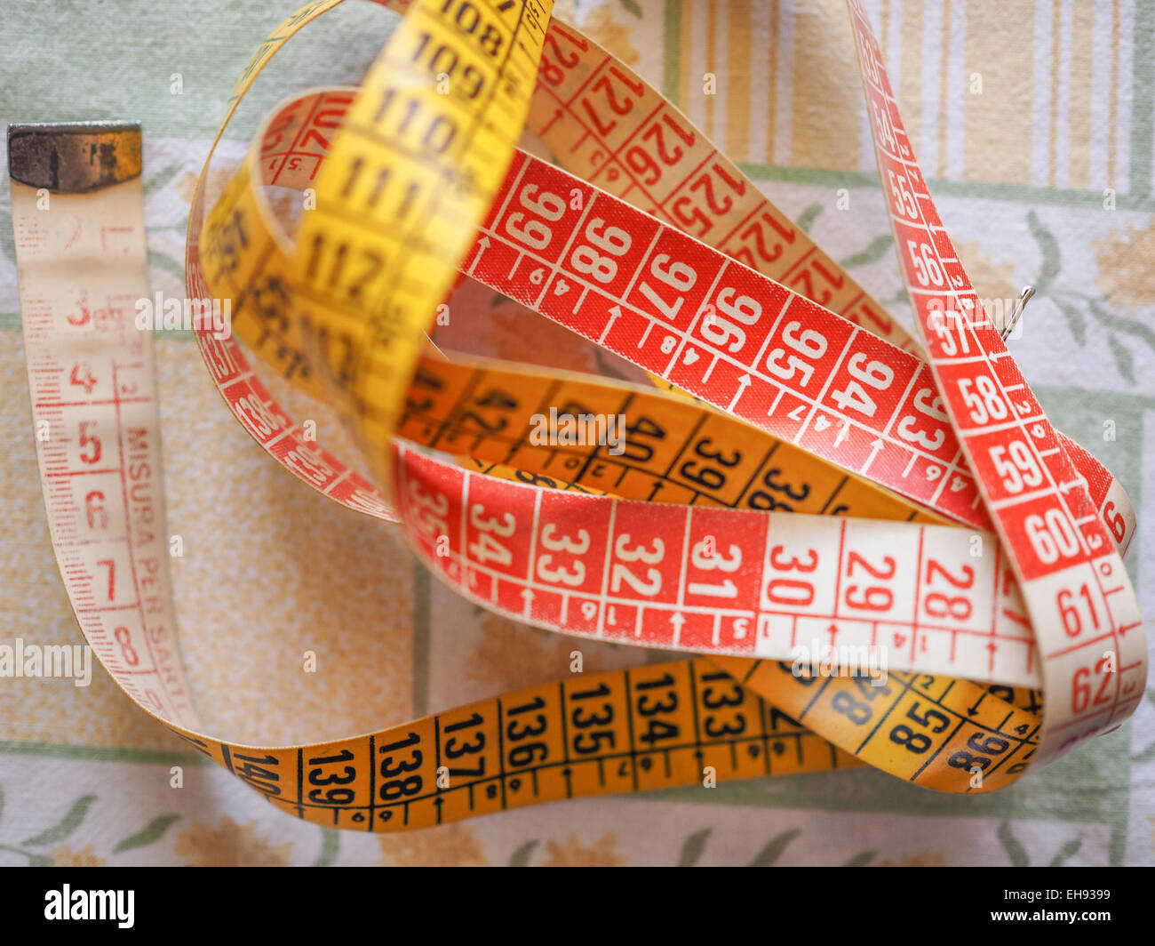 Measuring tape flexible ruler ribbon for tailoring - Stock Image