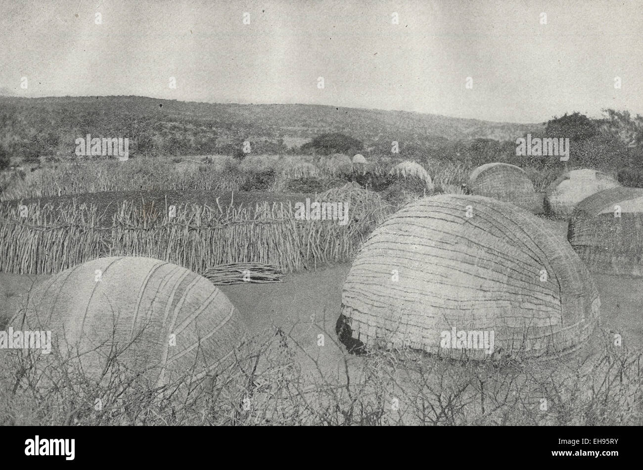 Zulu Kraal - This picture shows Zulu huts placed around the Kraal or cattle pen, circa 1898 - Stock Image
