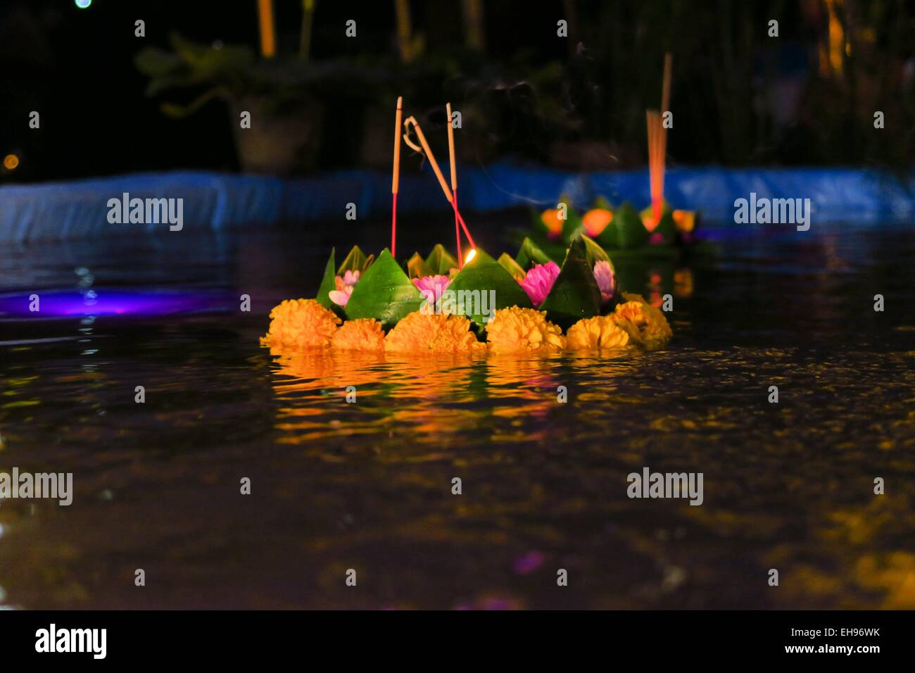 Small floating Krathong with candles and flowers - Stock Image