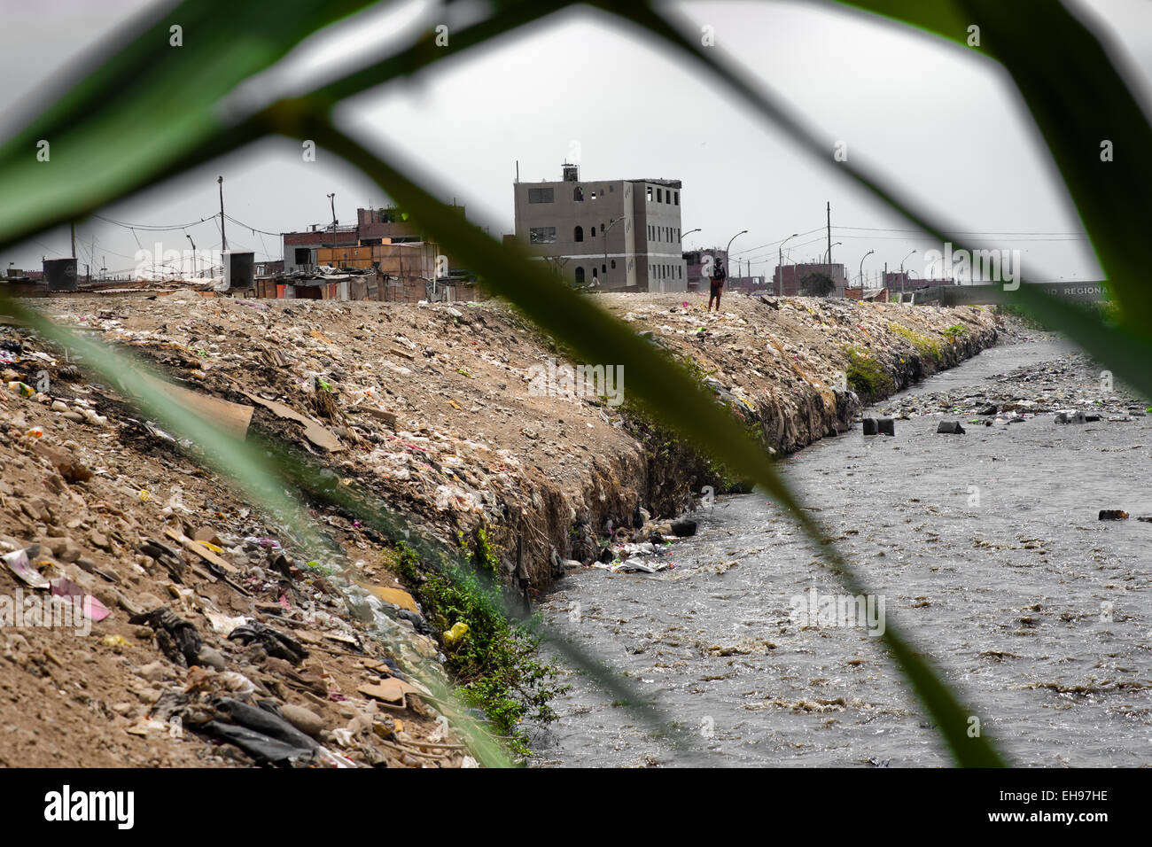 Waste and garbage are seen on the banks of Río Chillón, a heavily contaminated river flowing through Ventanilla, - Stock Image
