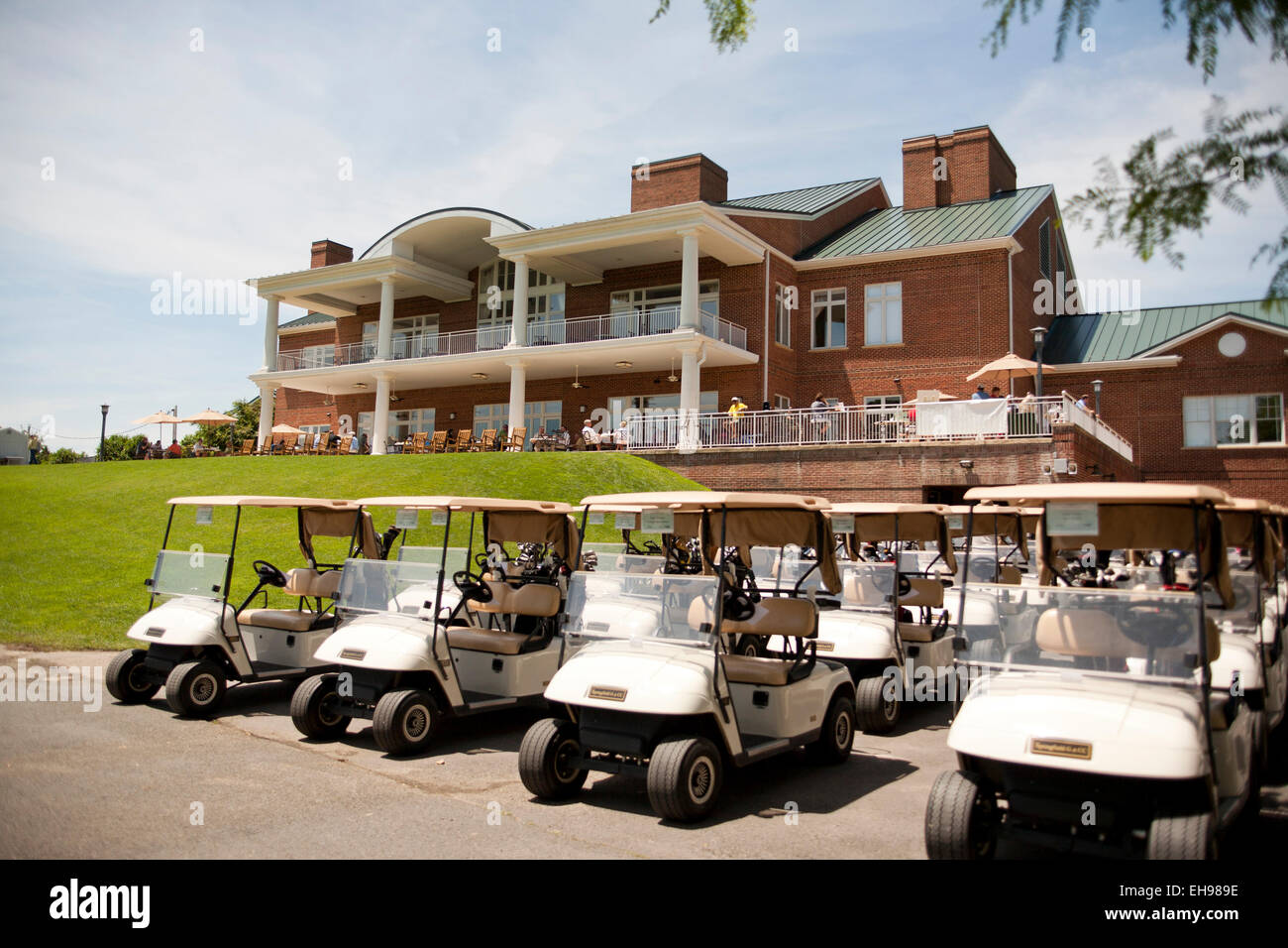 Carts lined up at golf course - USA - Stock Image