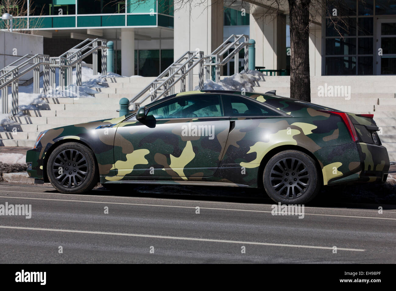 car with military camouflage pattern wrap usa stock photo