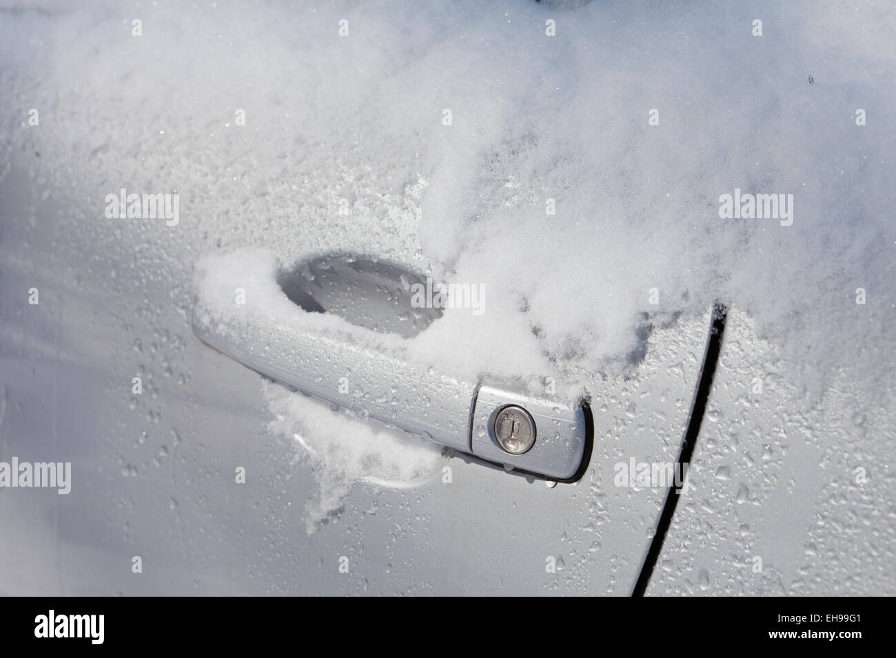 Snow on car door handle - Virginia USA - Stock Image