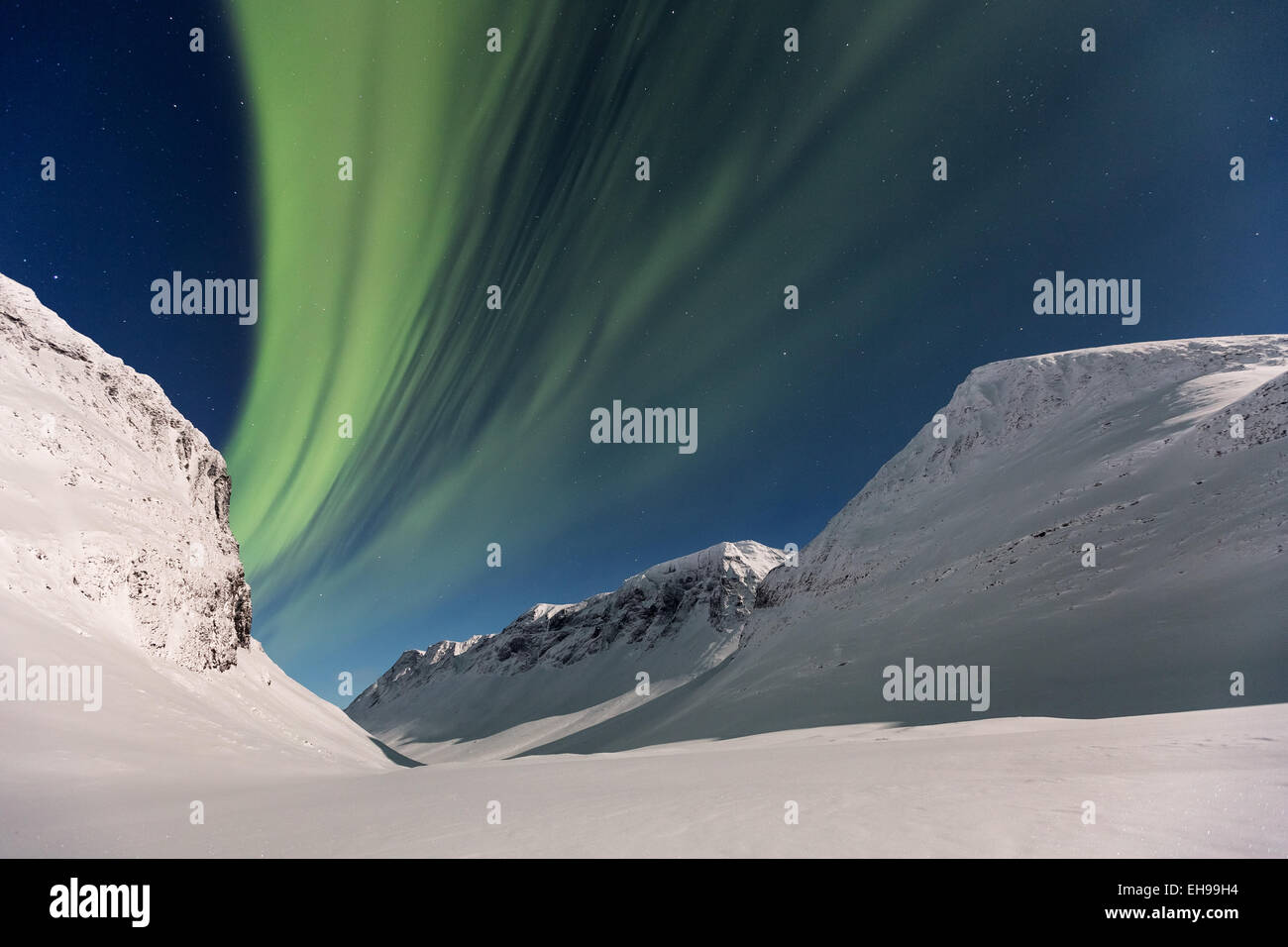 The northern lights seen at Nallostugan, Kiruna, Sweden, Europe, EU Stock Photo