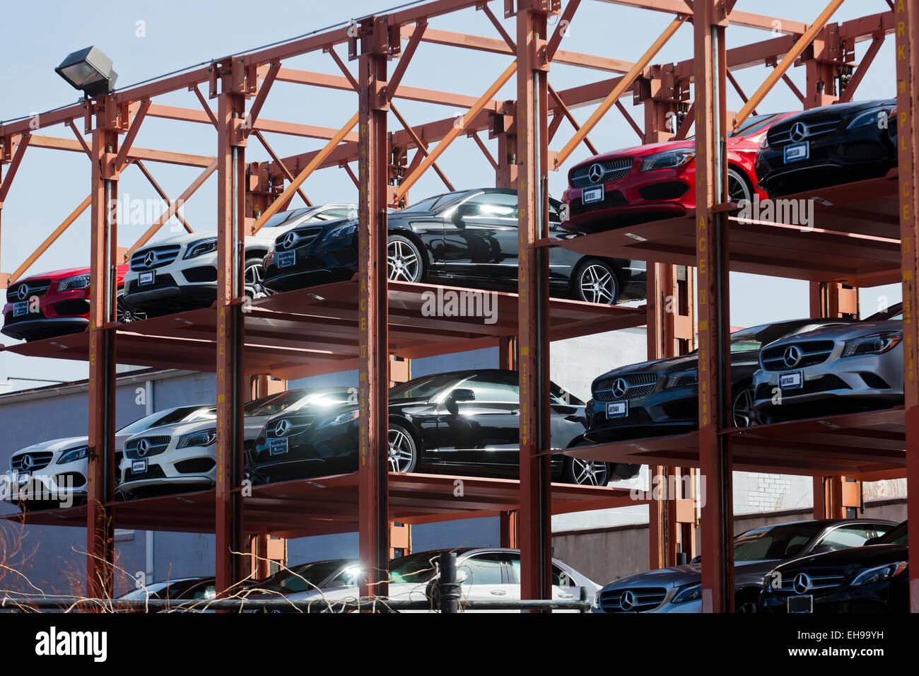 Temporary steel-framed car park structure at auto dealership