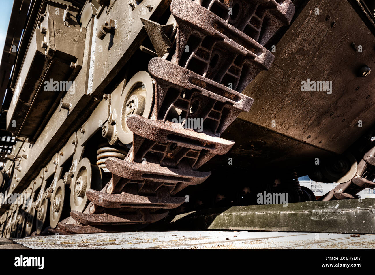 iron caterpillar racks of army tanks that have seen battle waiting to be called back into service and duty - Stock Image