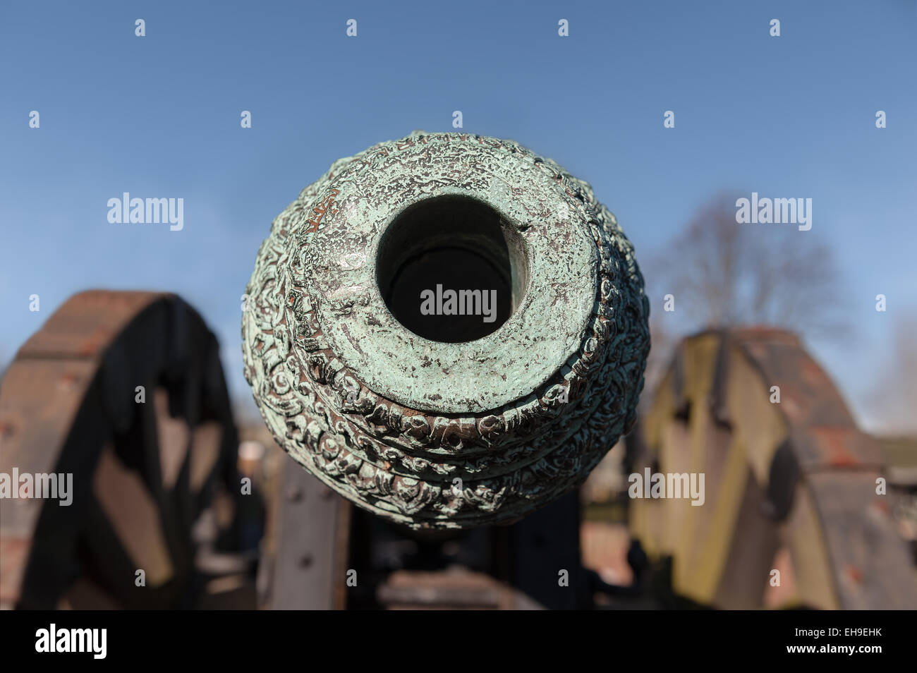 looking down the barrel Weathered patina on Light British copper bronze field cannon gun with fine decoration and - Stock Image
