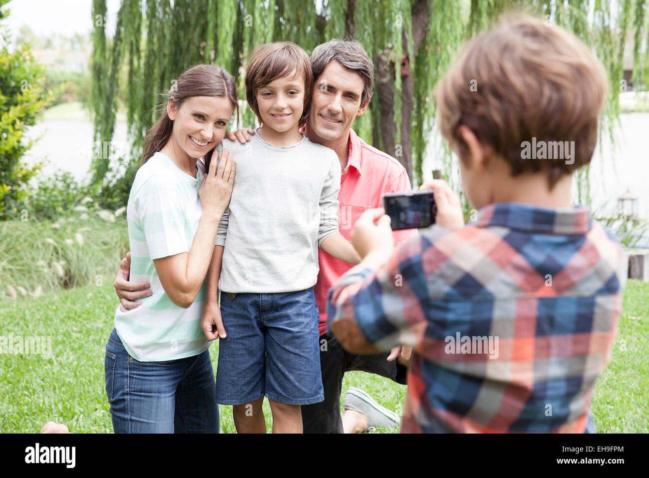 Boy photographing family - Stock Image