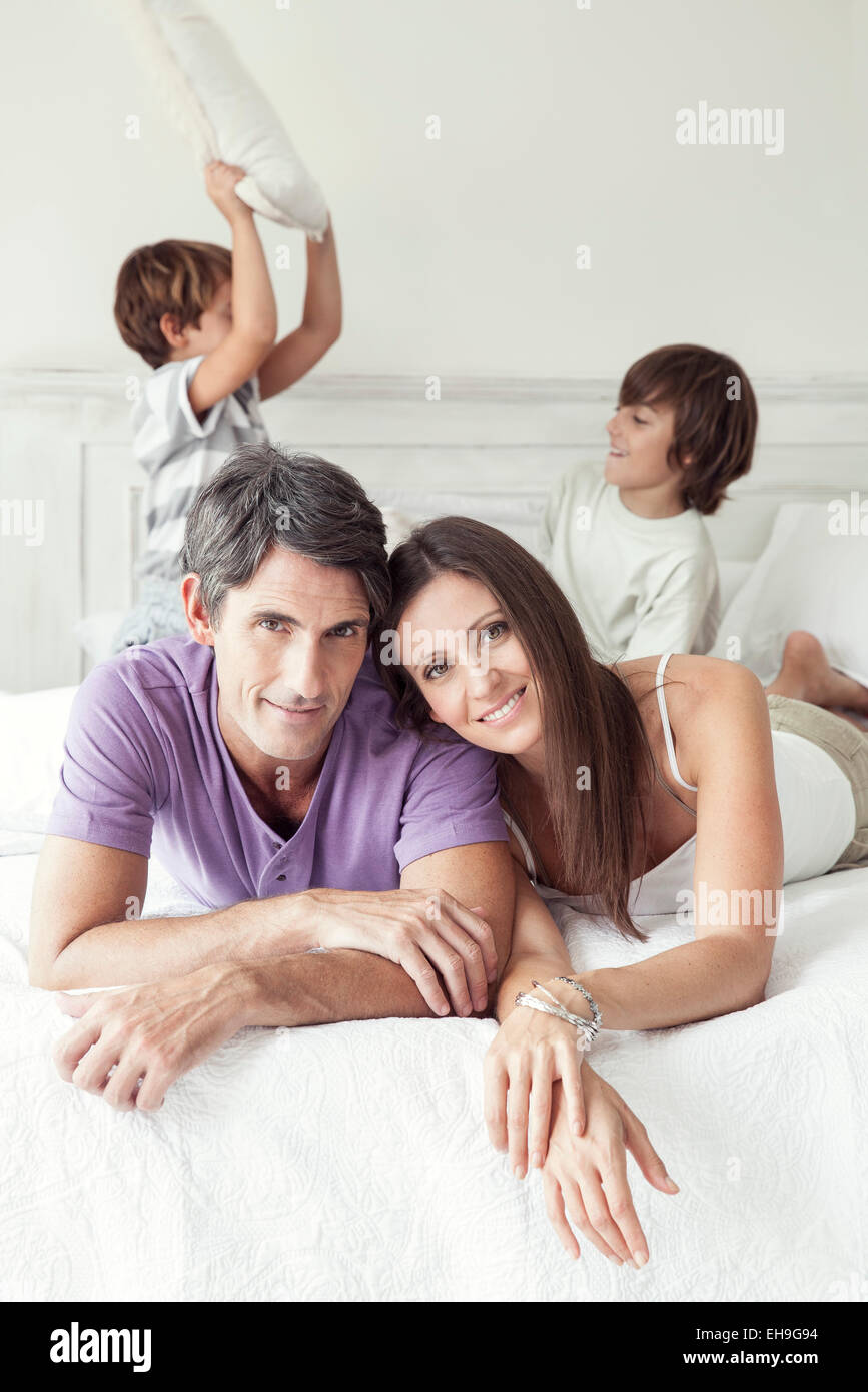 Parents with young boys, portrait - Stock Image
