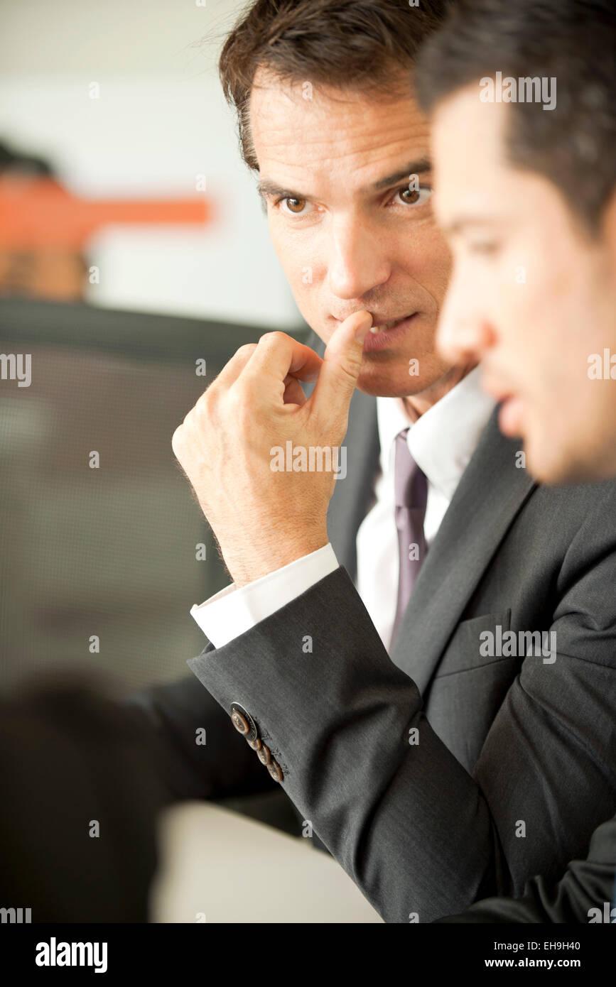 Businessmen negotiating - Stock Image