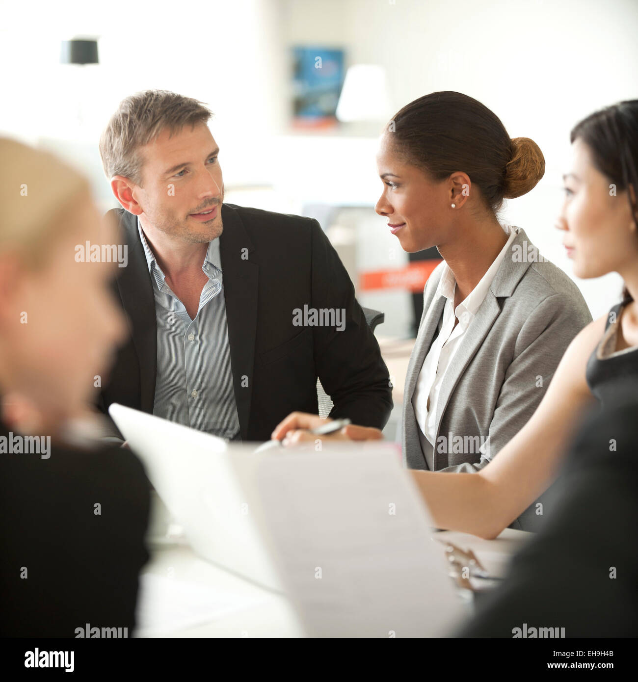 Businesspeople at meeting - Stock Image