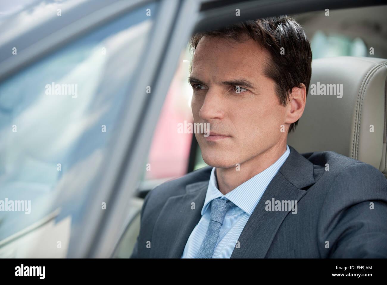 Businessman stuck in traffic - Stock Image