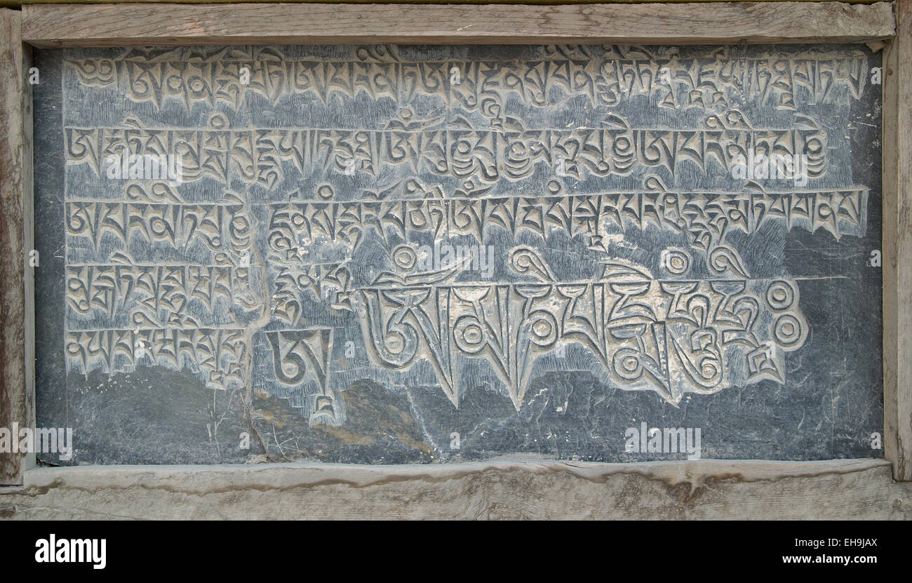 Tibetan stone manuscript with nepali words Stock Photo