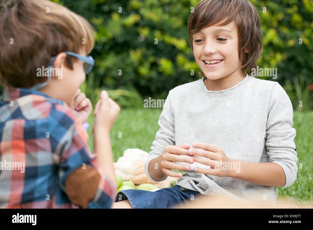 Boys playing hand game - Stock Image