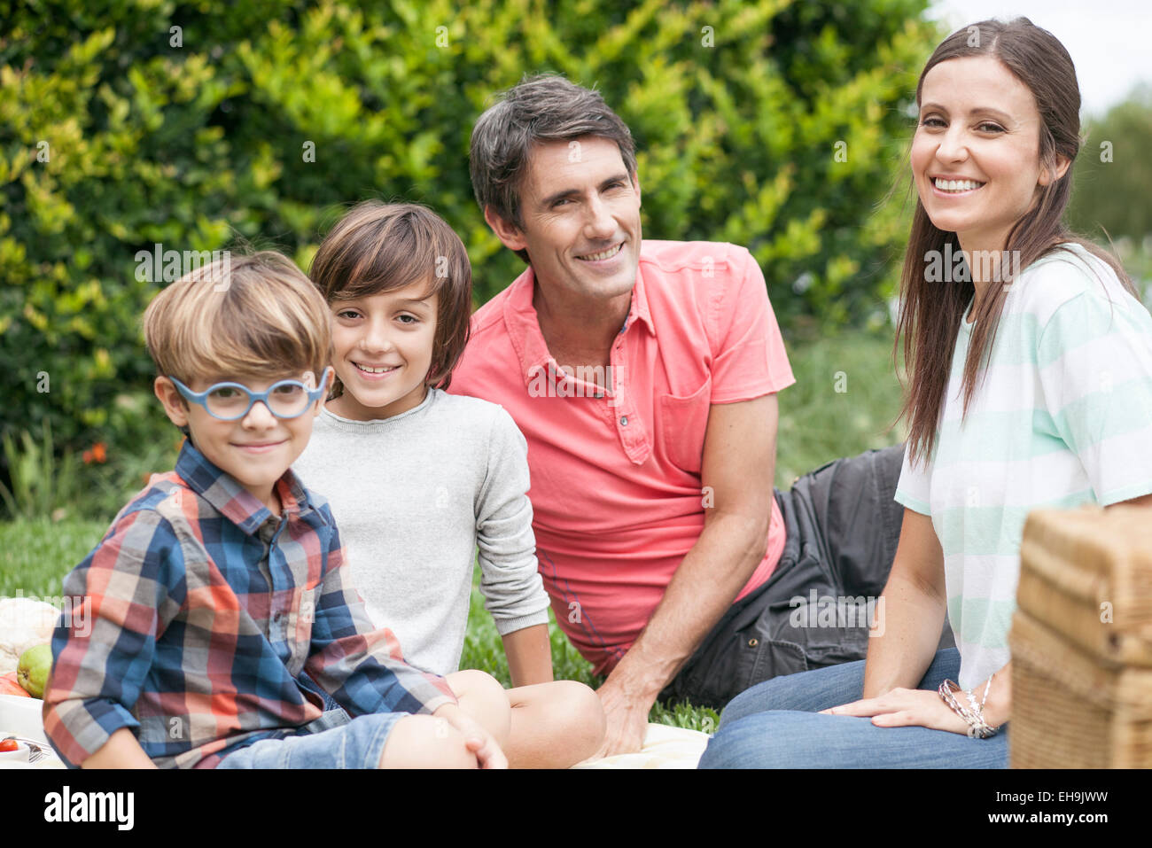 Family at park together, portrait - Stock Image
