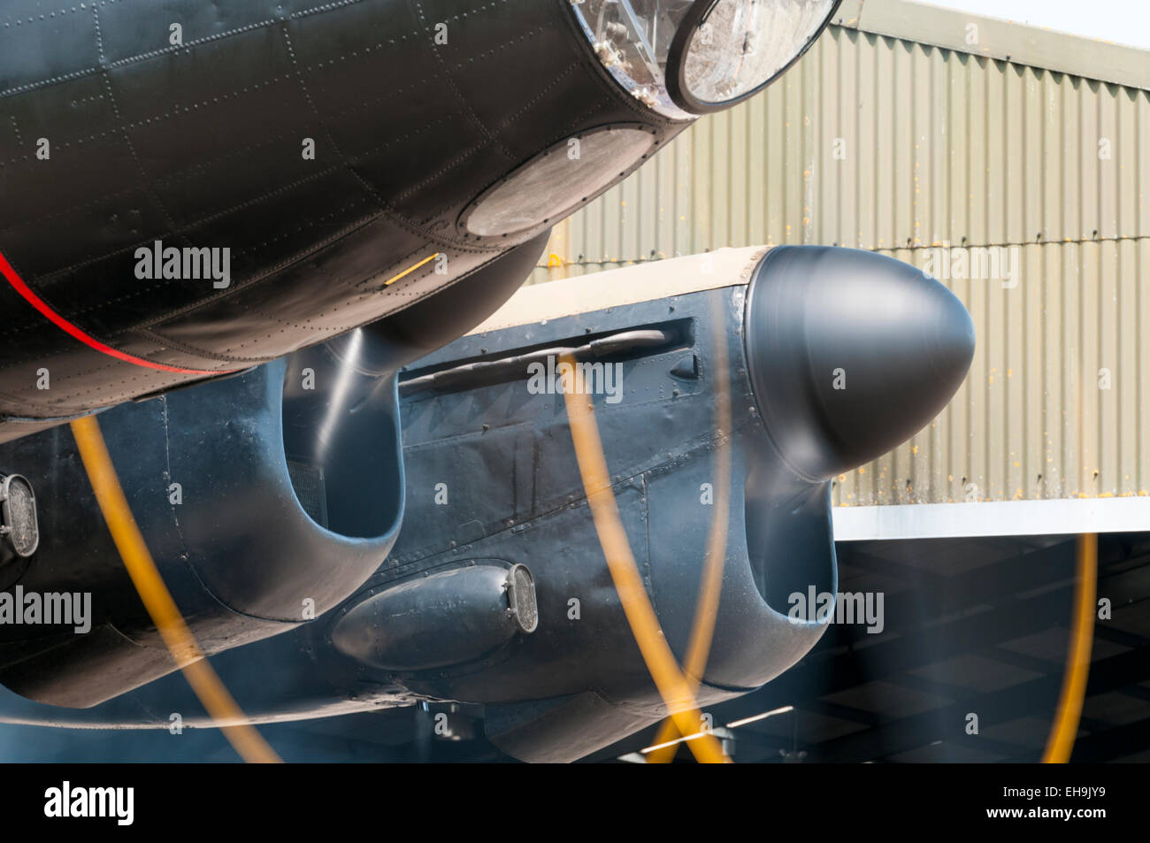 RAF Lancaster bomber propellers rendered as a spinning blur by a long exposure - Stock Image
