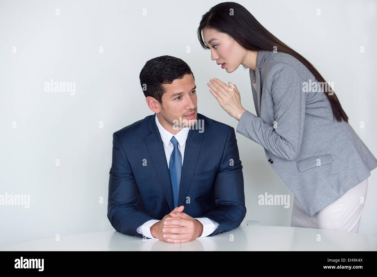 Woman delivering urgent message to executive - Stock Image